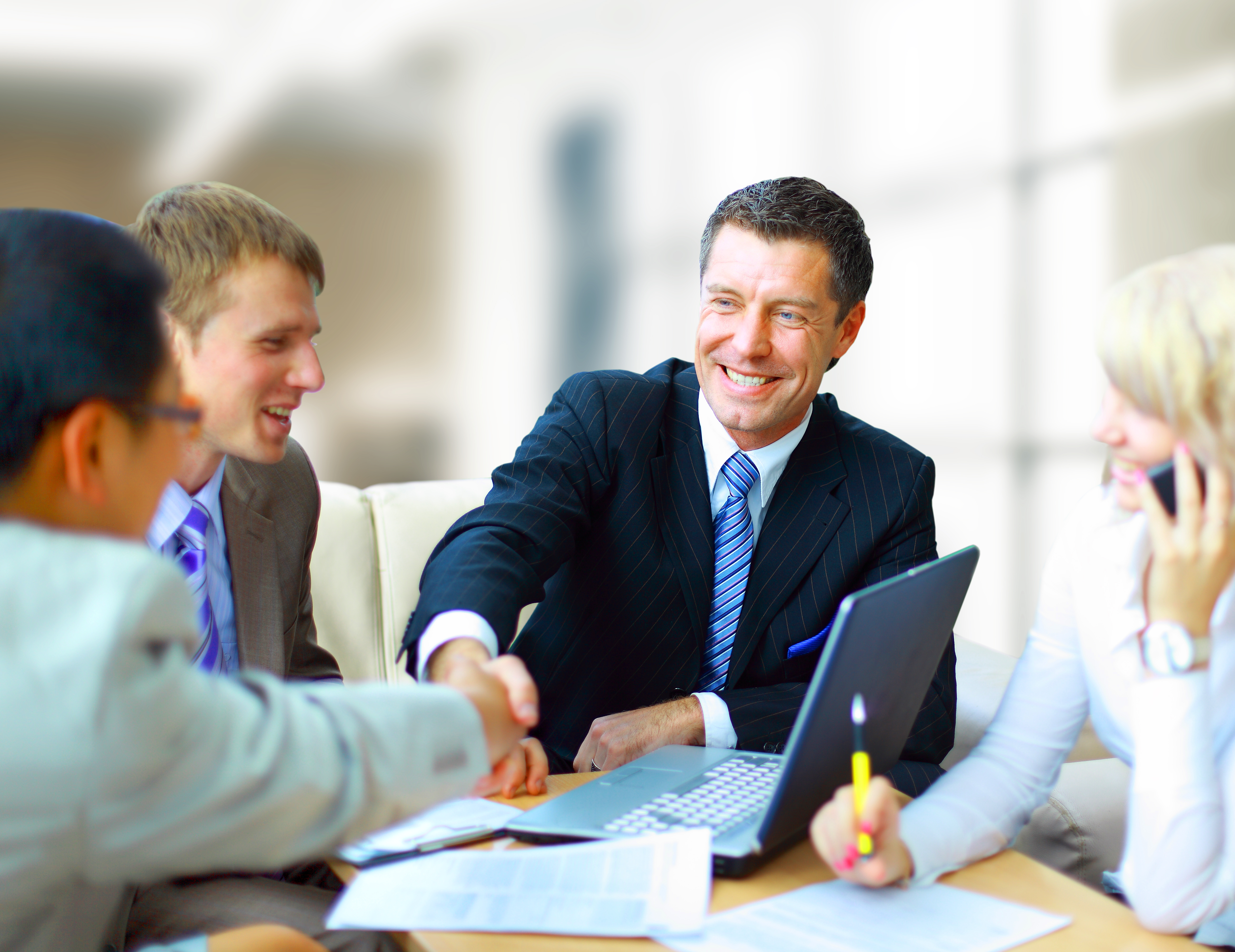 Business shaking hands, finishing up a meeting real estate investing