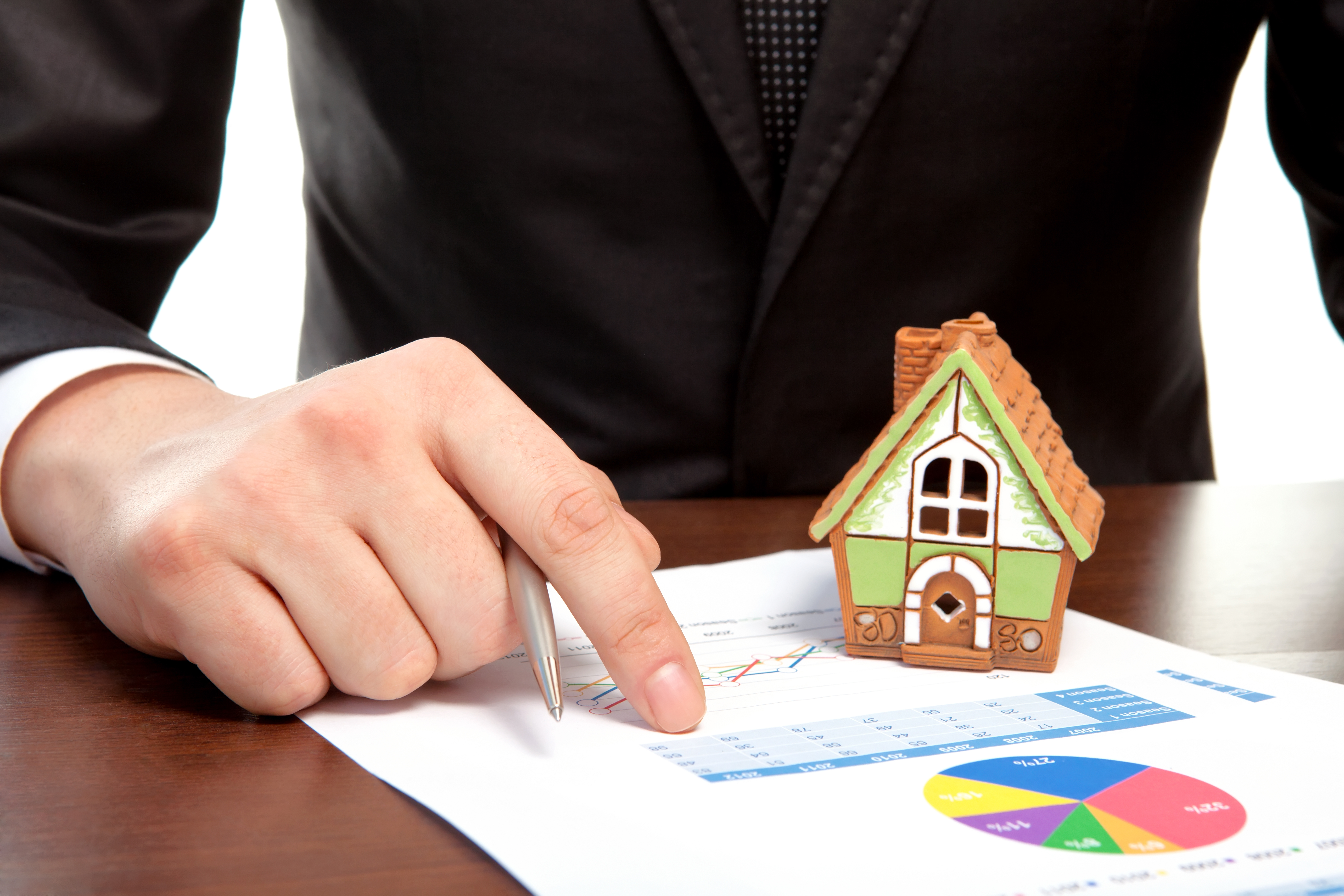 Businessman sitting at the table and sign a contract Expert Property Manager