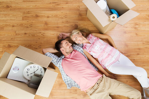 Couple with big cardboard boxes moving to new home