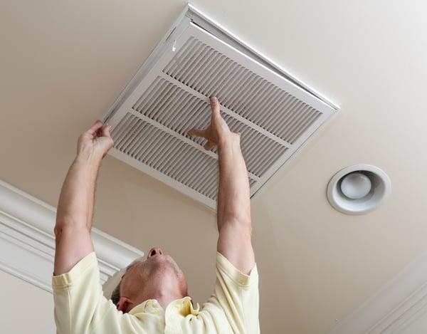 Man checking HVAC Systems Routine Maintenance