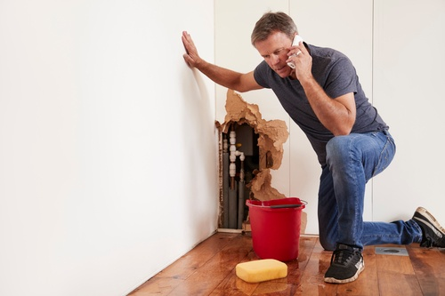 man cleaning the floor property maintenance