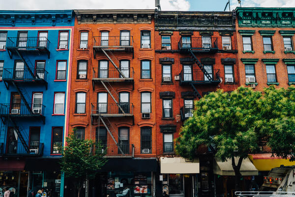 Homes with red, orange, and blue bricks Real Property Management