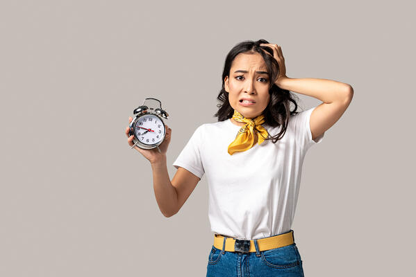 Worried woman holding a clock Property Management