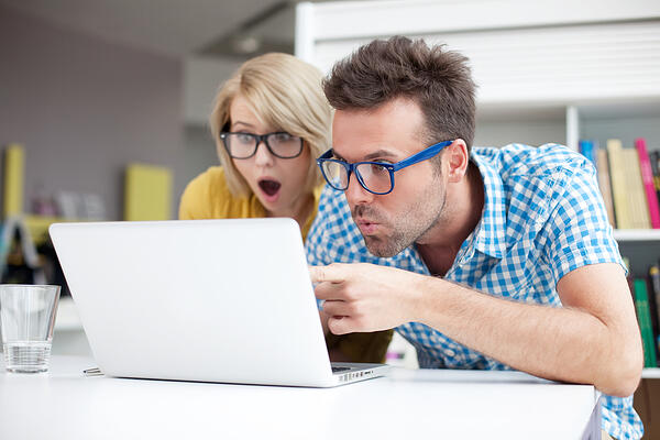 Man and woman looking at computer screen Real Property Management