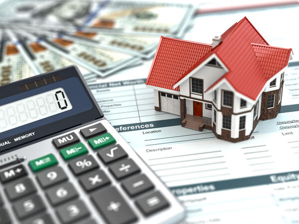 Calculator, money and model house on a document Real Property Manager