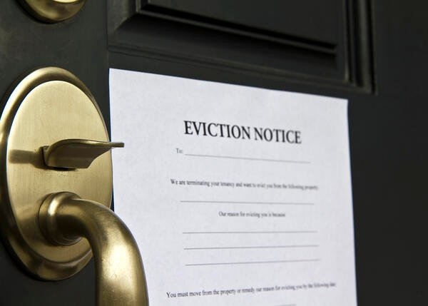 Eviction notice attached to a door Managing a Rental Property