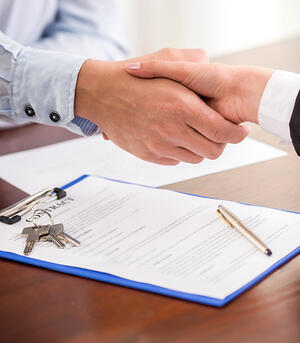 handshake and signing of papers local property management