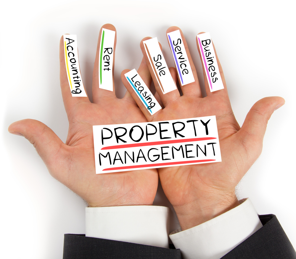 property management concept, property management services written on hands. Real Management Property