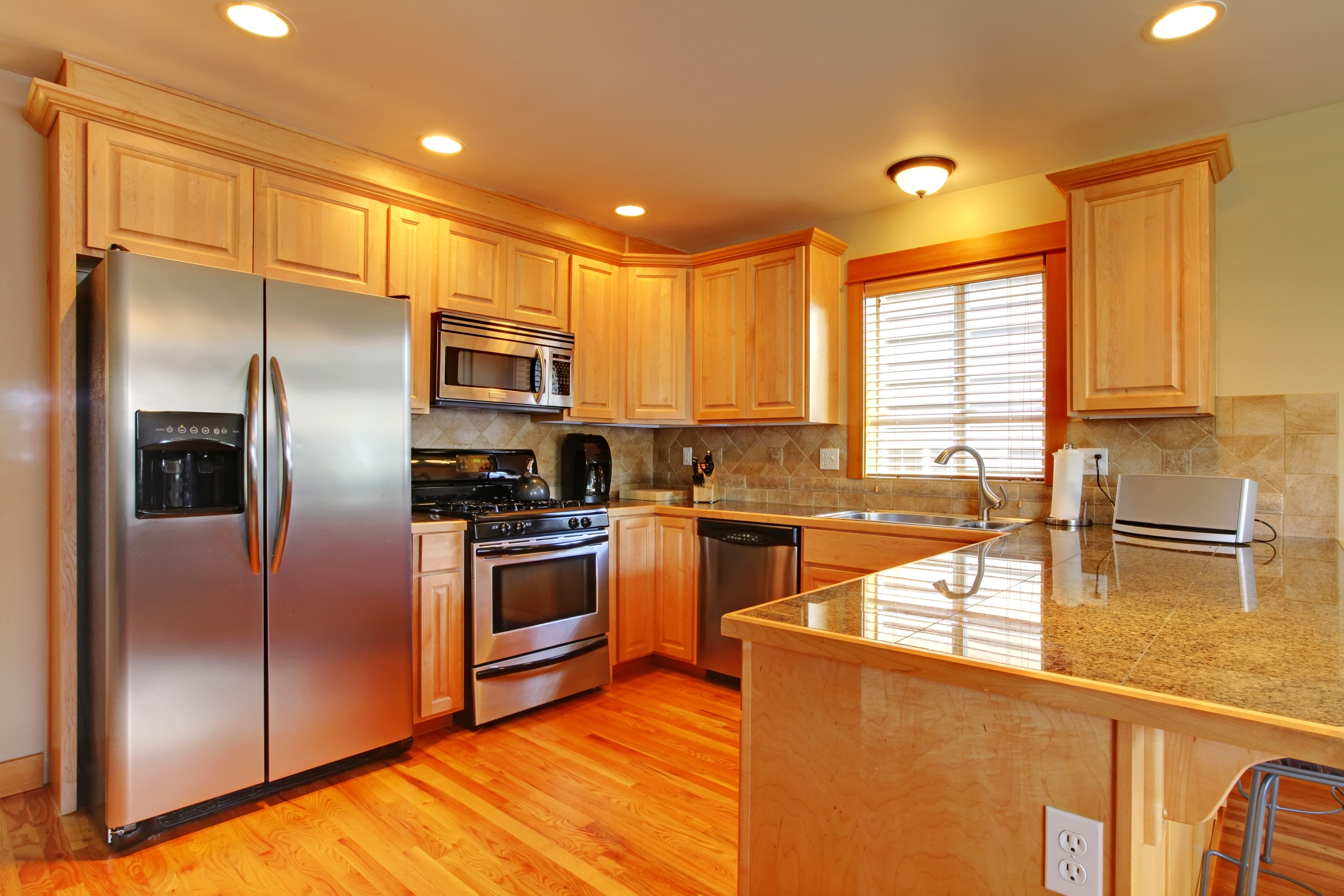 Golden maple cabinets kitchen with new appliances, maintenance