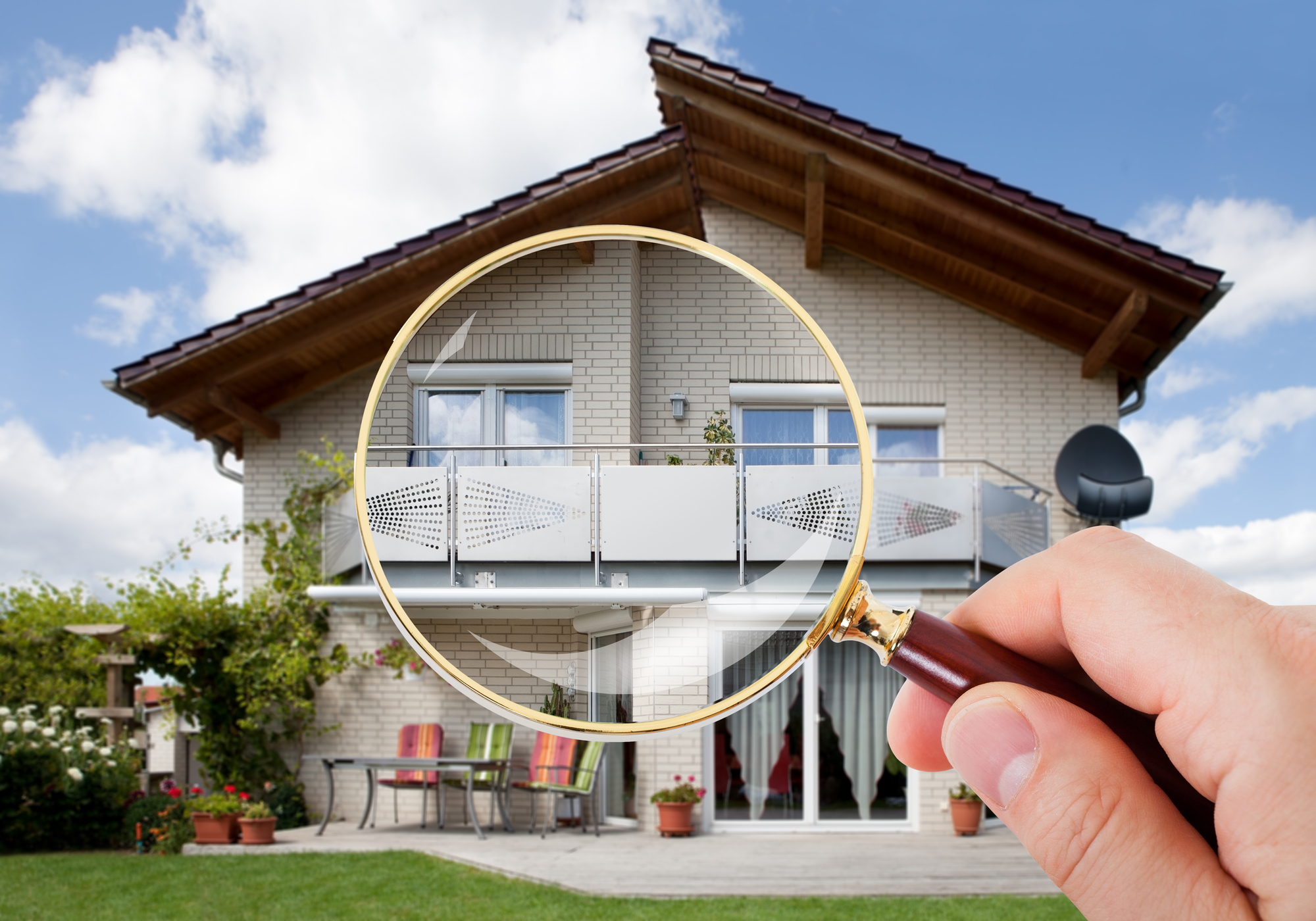 Hand With Magnifying Glass Regular Property Inspections