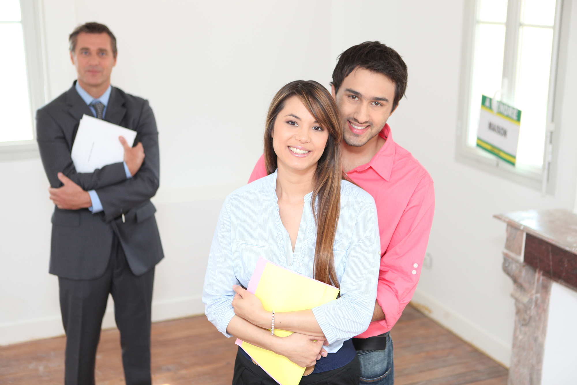 Happy young couple visiting house Property Inspection