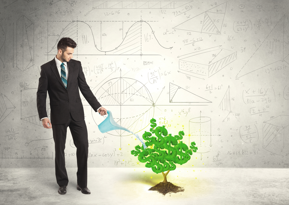 Business man watering a growing green dollar sign tree concept, property manager