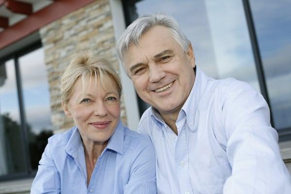 Cheerful senior couple looking at camera Baby Boomers