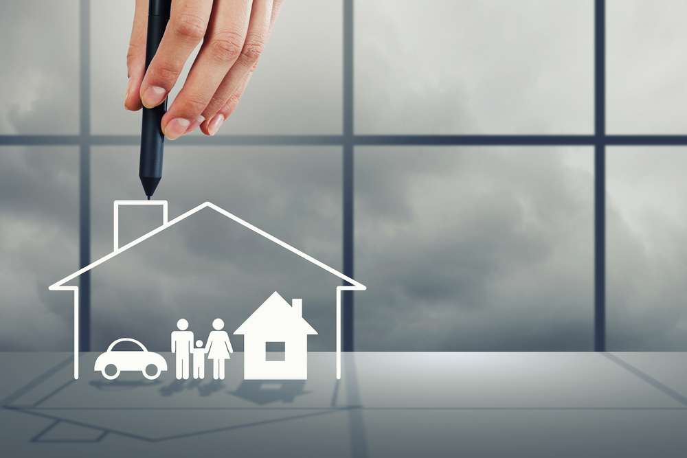 Close up of human hand drawing happy family and real estate concept, rental property
