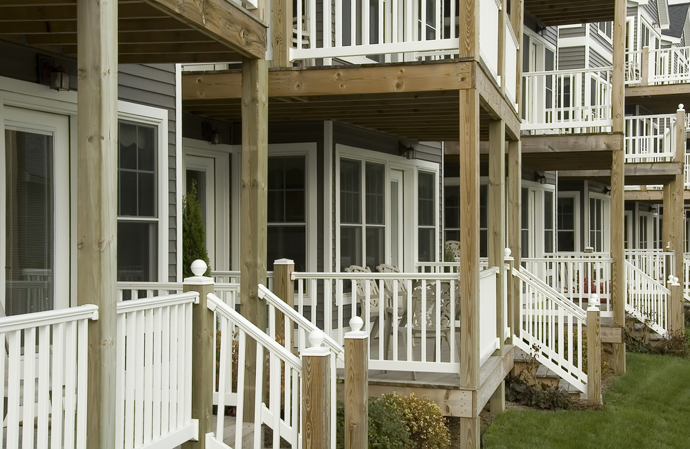Front porches of similar homes lined up in a row comparable properties