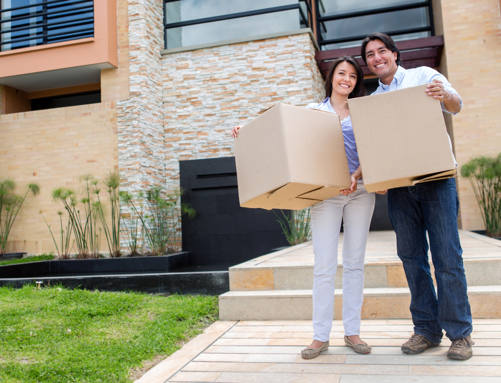 Happy couple moving into a new house Live Oak Rental Property