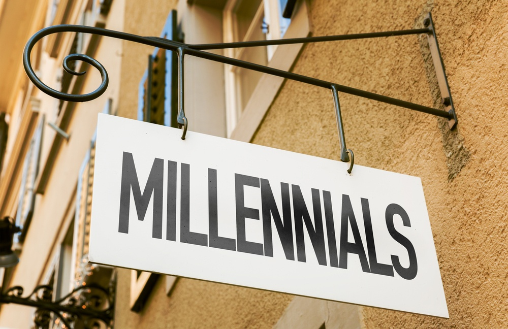 Millennials sign in a conceptual image, real estate tech trends
