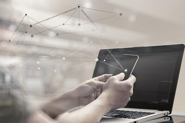 double exposure of young designer working with smart phone and computer in bed as concept, real estate investors