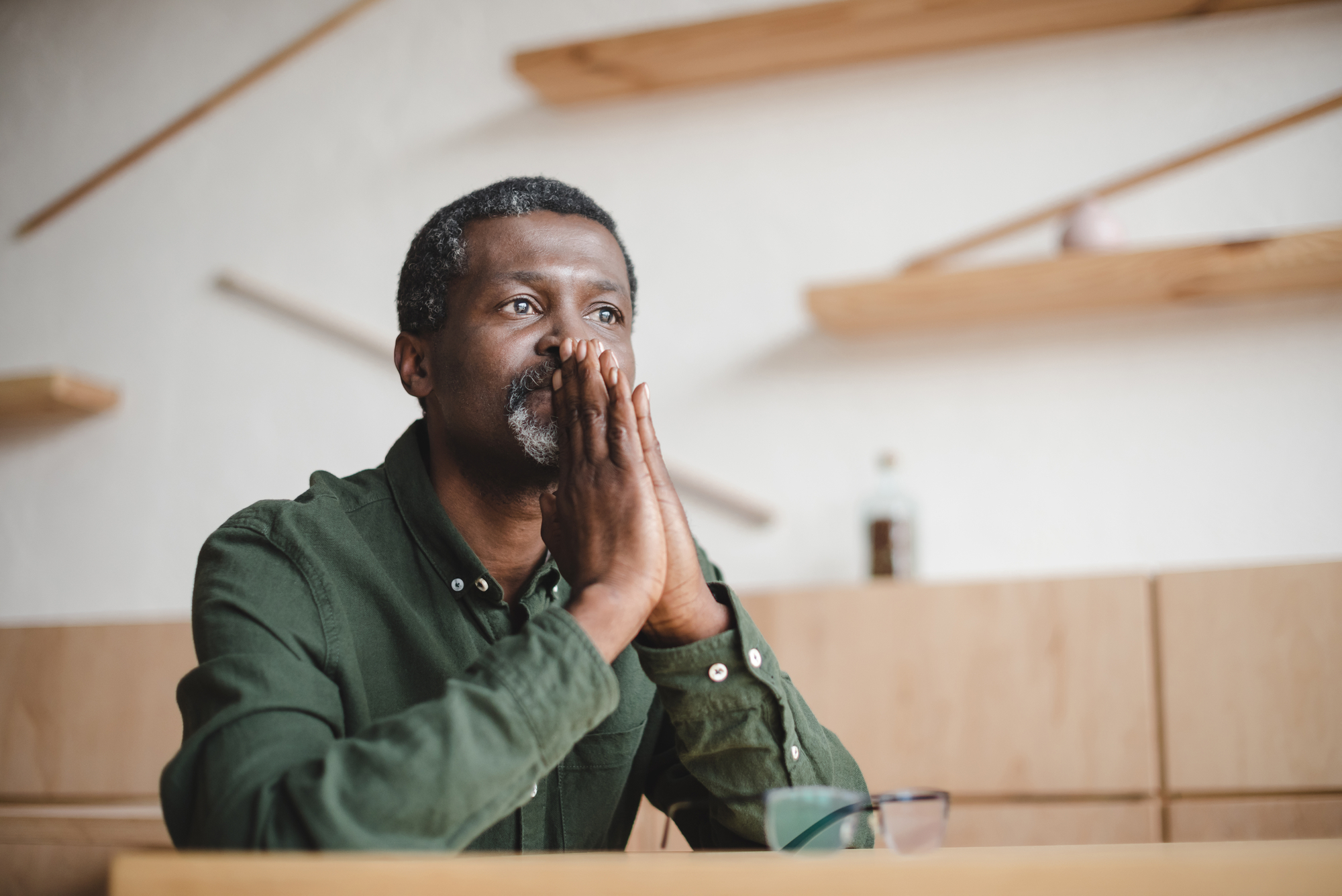 Thoughtful mature man sitting in cafe
