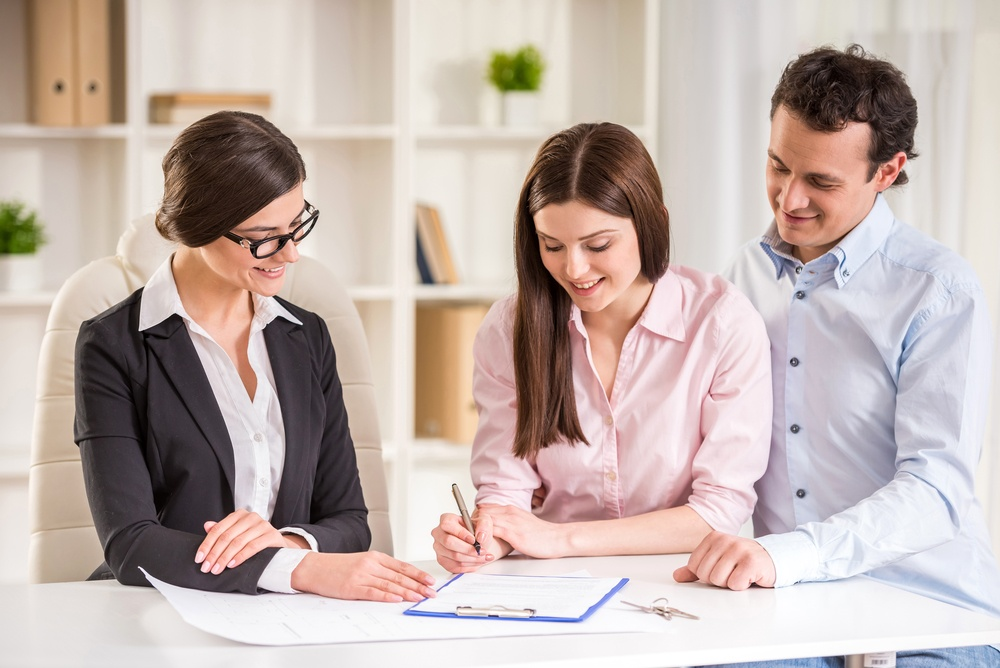 Couple signing agreement Property Management Company