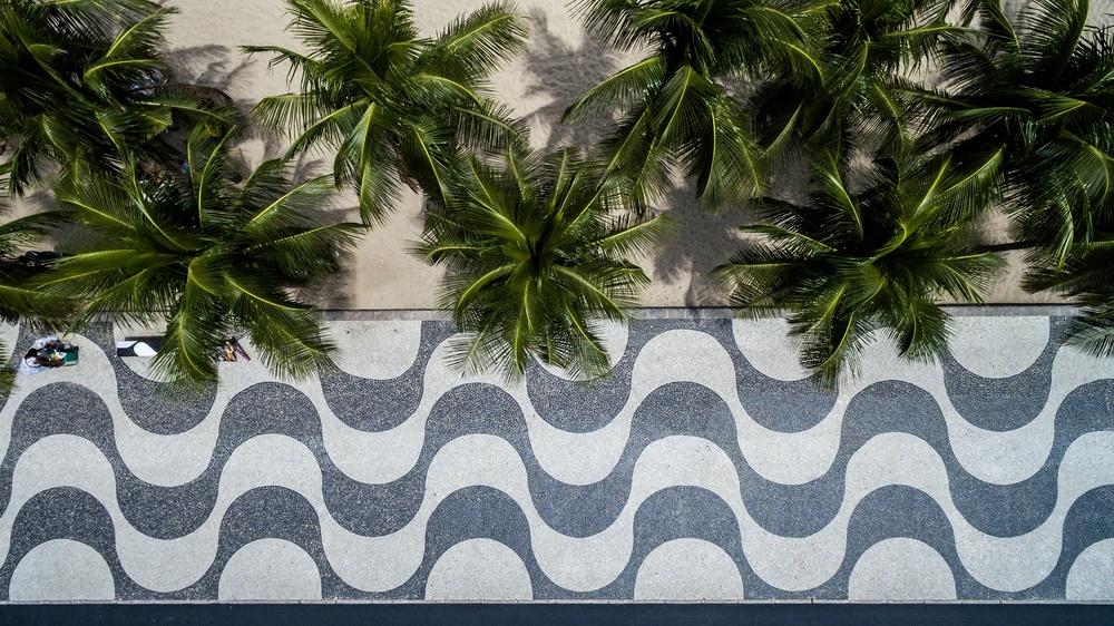 Top View of Copacabana beach with mosaic of sidewalk in Rio de Janeiro. Brazil San Antonio Property Manager